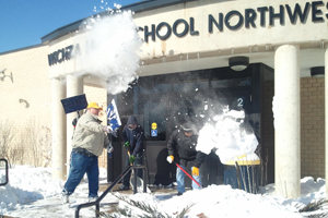 Braving the cold: Custodians endure negative temperatures to clear snow