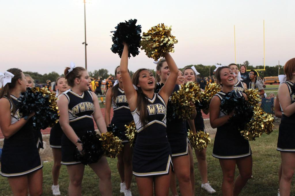 The cheerleaders energize the crowd at Thursday's game.