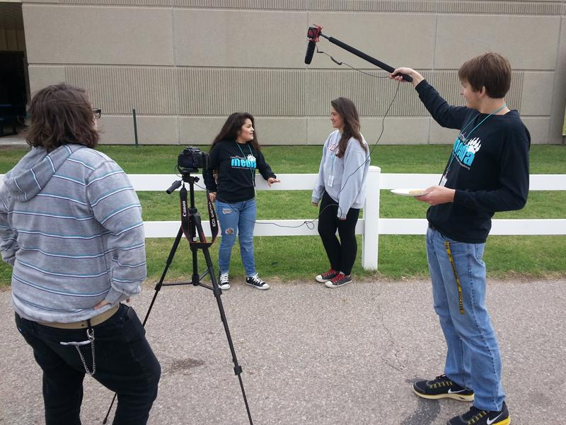 Jordan Coss, Jozabeth Garcia, Tatum Sturdivant and Cody Kretchmar create a video during a journalism competition held at the State Fair in Hutchinson on Sept. 11.