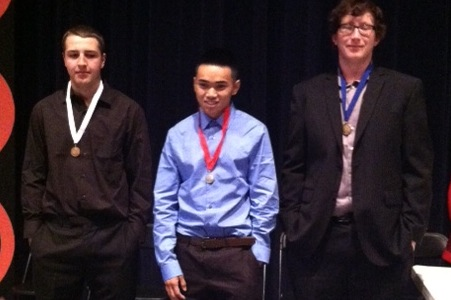 Senior Malcolm Graham poses with fellow DECA members at the end of the competition.
