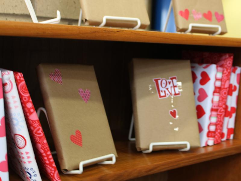 Books wrapped in Valentine-themed paper are available for unwrapping and check-out in the library.