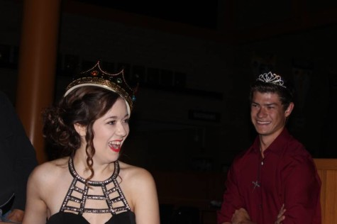 Seniors Andrew Minter and Holly Brown swap crowns after being named homecoming royalty