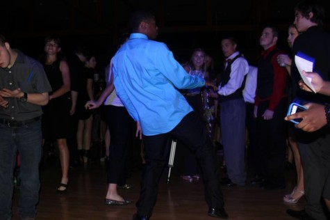 Senior Kole Parker seen dancing in the middle of a group at homecoming
