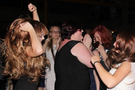 Students seen letting loose and dancing together at homecoming.