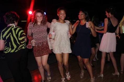 Sophomores Anna Voncannon, Raeanna, Glover, and Sierra Henderson doing a kick line at homecoming.