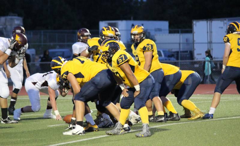 Northwest football team prepares to kick.