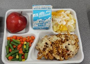 Pasta ragu, vegetable medley and a fruit dish make up the plate prepared by students at the Cooking up Change competition on Dec. 1.