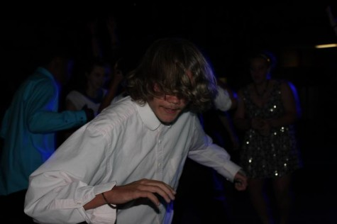 Sophomore Duncan Scriven feeling the music during homecoming 2015.
