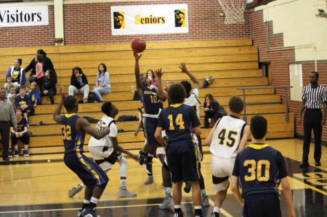 Freshman Roy Johnson goes in for layup against southeast in sophomore game.