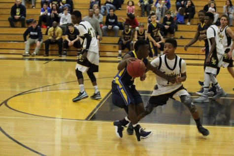 Freshman Roy Johnson dribbles against southeast defense in sophomore game.