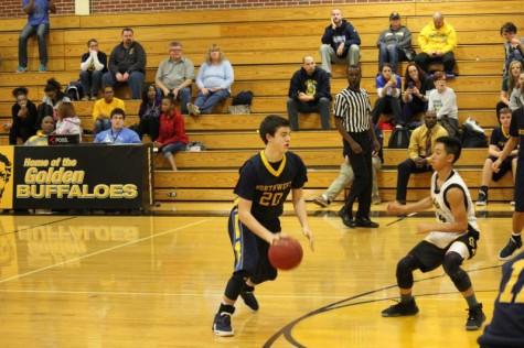 Sophomore Jake Carter dribbles against Southeast defense in sophomore game.