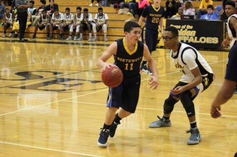 Sophomore Chase Taylor dribbles down court against Southeast defense.