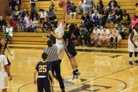 Freshman Kale Patterson jumps at the tip off of the sophomore game at Southeast.