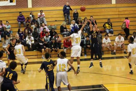 Freshman Jacob Harmon shoots a 3-pointer in the freshman game.