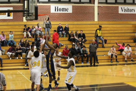 Freshman Percelle FInch shoots a shot from under the basket in the freshman game