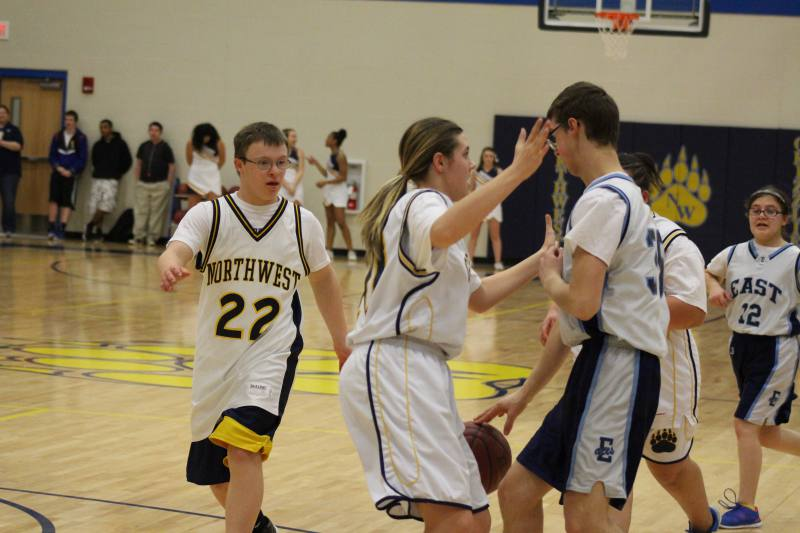 Blake & Shayla try to stop the East player from scoring.