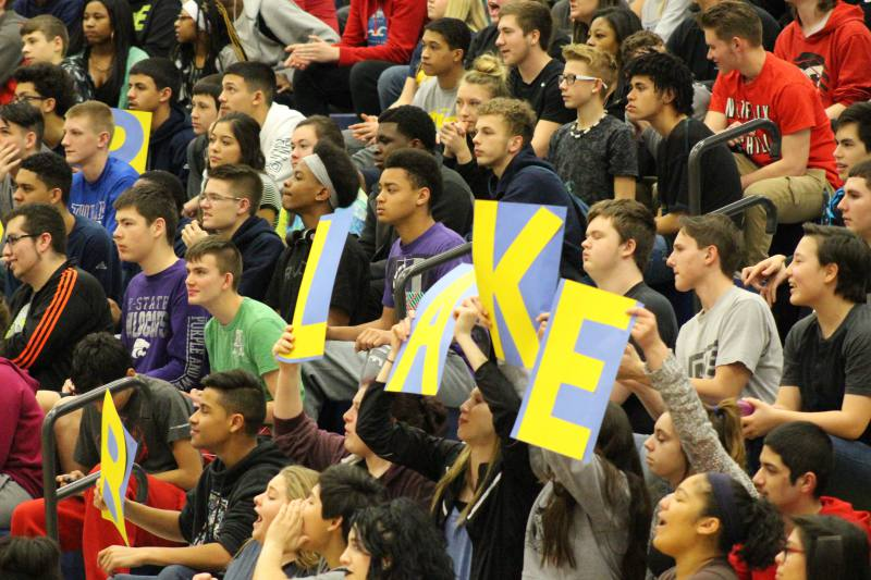 Students watch intensely, while cheering on Blake.