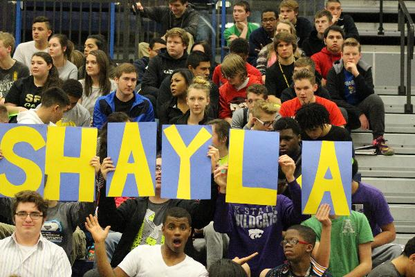 Students spell out Shaylas name out in the crowd.