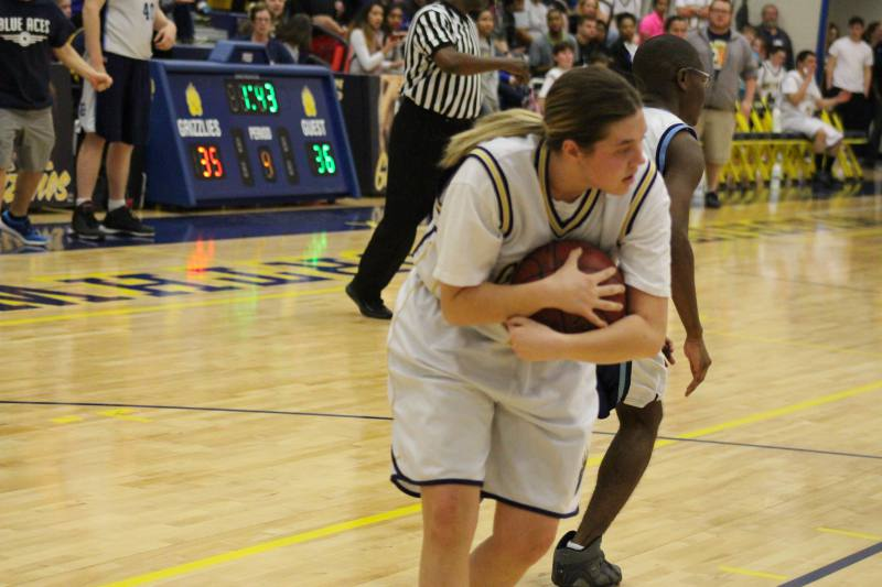Shayla gets the rebound and protects it.