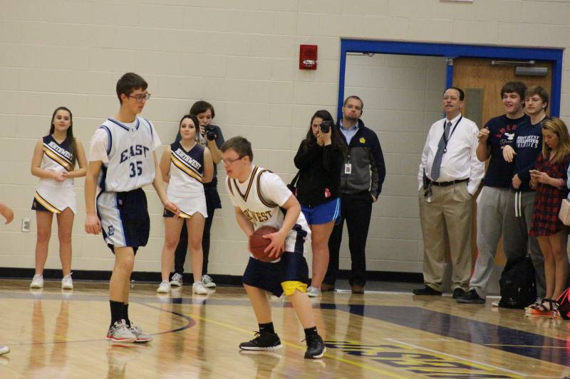 Blake holds onto the ball as he tries to get pass his opponent.