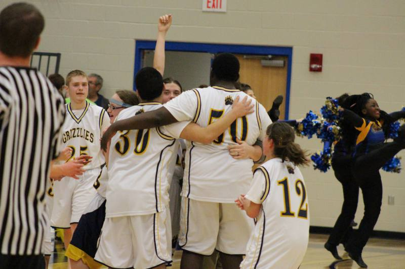 The team celebrates their victory.
