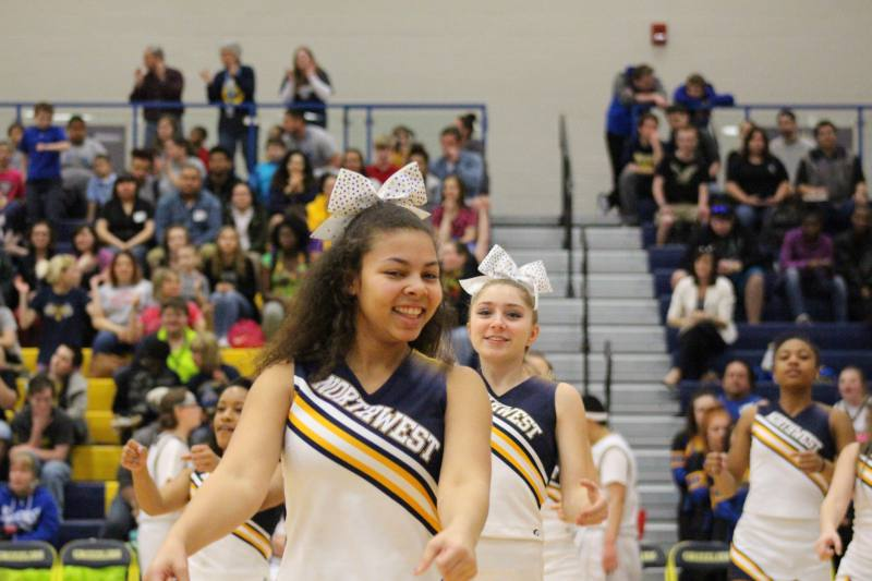 Sophomore Kristiana Blythe cheers during the game.