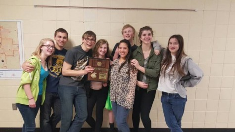 The scholars bowl after winning Regionals.