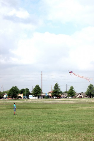 Sophomore Tanner Crum holds onto a colorful kite.