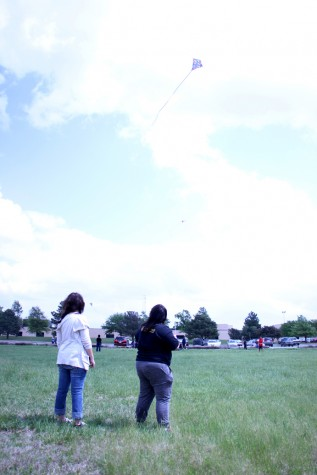 Senior Serena Leyba and freshman Amber Gusse fly a kite together.