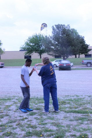 Wallentine hands a kite over to junior Maurice Reed.