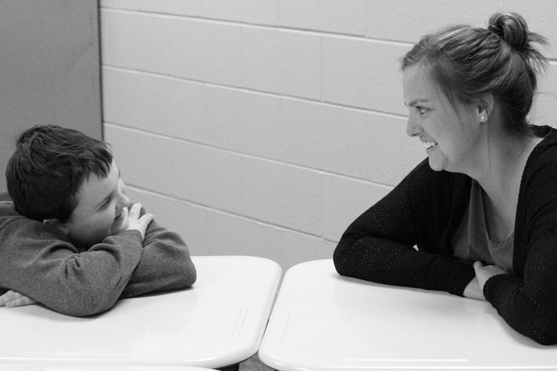 Ashton Latta, son of technology specialist Brian Latta, shares a laugh with Maize South paraprofessional Madeliene Rainbolt.