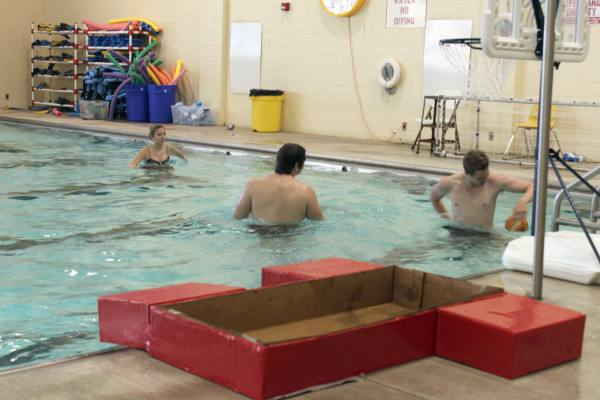 Students enjoy a game of basketball after boat races on May 10