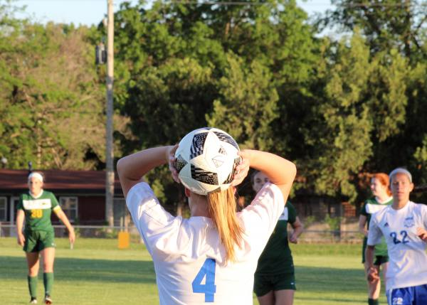 Sophomore Madison Driskill throws in the ball after it goes out of bounds at Tuesdays Varsity soccer game against Bishop Carroll.