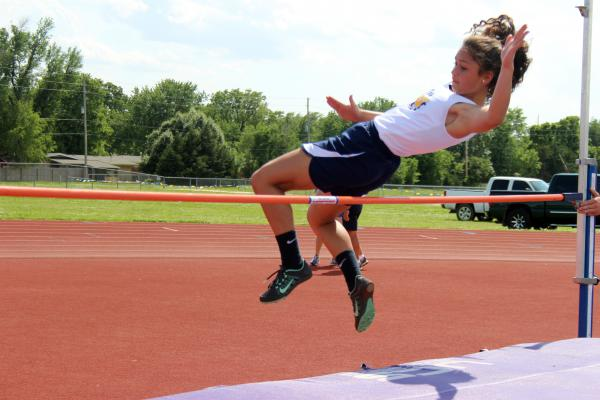 Freshman Ashley Bouddhara practices her high jump at the Northwest track meet.