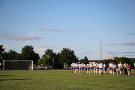 Northwest women's varsity soccer stands in silence, during the national anthem.