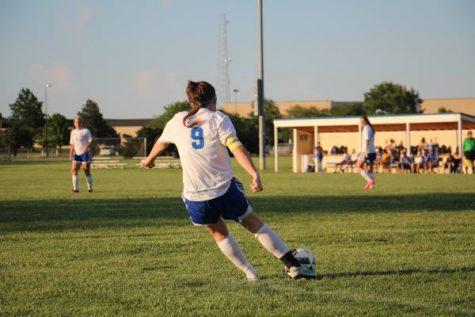 Captain Whitney Weiford takes goal kick.