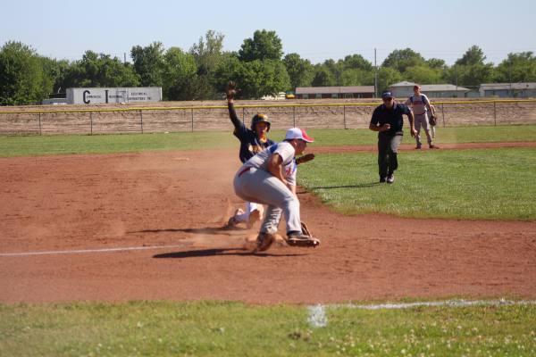 Jace Hanson sliding into 3rd base. SAFE!