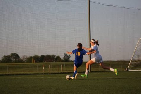 """Freshman Brittan Murray races around Washburn defender to cross the ball. She is one of the few freshman to make varsity as a freshman. """"Im happy to be playing along side some of the best girls in the city,"""" said Murray."""