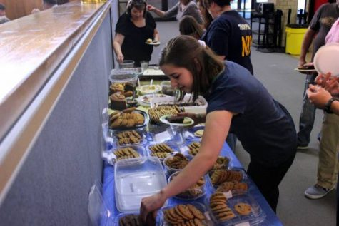 At the music awards banquet on May 5 Junior Rachel Kitchen loads up on desserts. All the families were to bring one main dish and either a dessert or salad depending on last name.