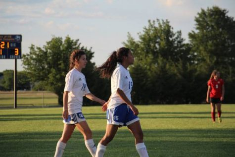 Brittan Murray (9) and Emily Rodriguez (9) walking to next play