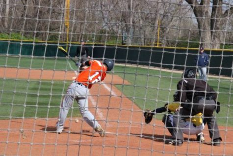 Olathe East batter hits a foul ball off his foot.