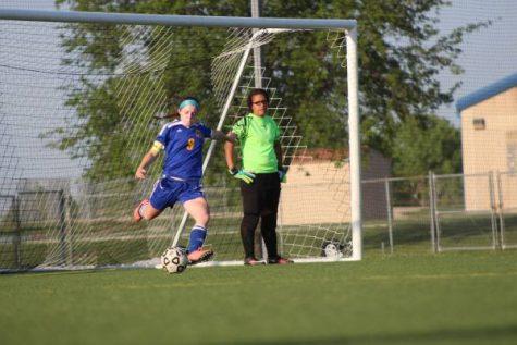Junior Whitney Weiford takes goal kick.