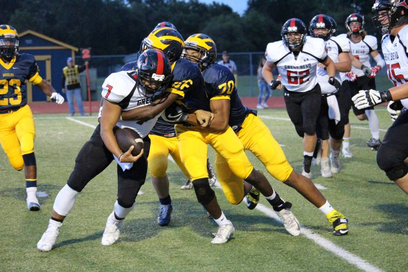 Sophomores Percelle Finch and Marcus Hicks make a double tackle against Great Bend.