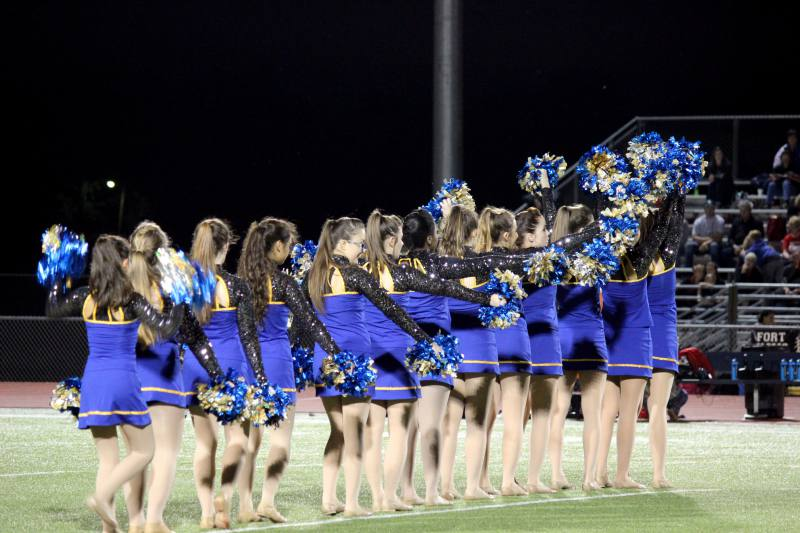 The dance team performs during half time.