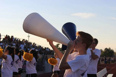 Sophomore Zach Chad chants into the megaphone during the BC game.