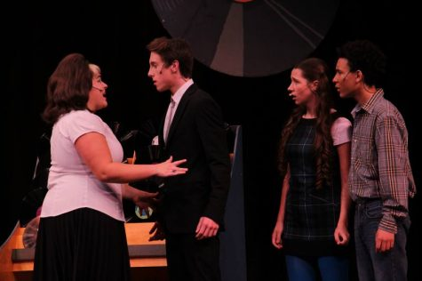 Casts of the musical stand in confusion while the other two talk about the future.