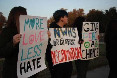 Students hold a 'peace rally' before school to promote love and equality.