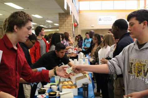 Students buying food from YE businesses.