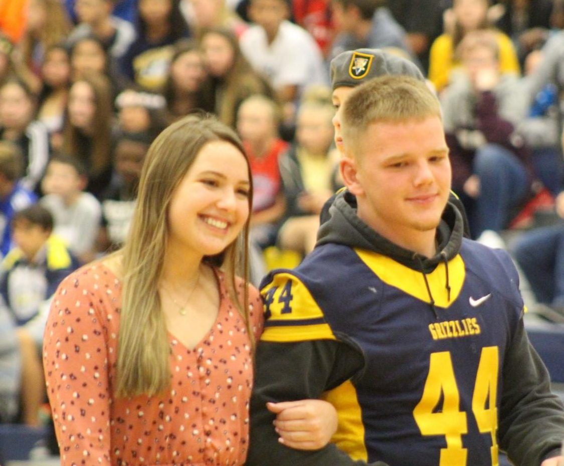 Josh Carter (12) and Katie Carter (12) walk at the homecoming pep assembly