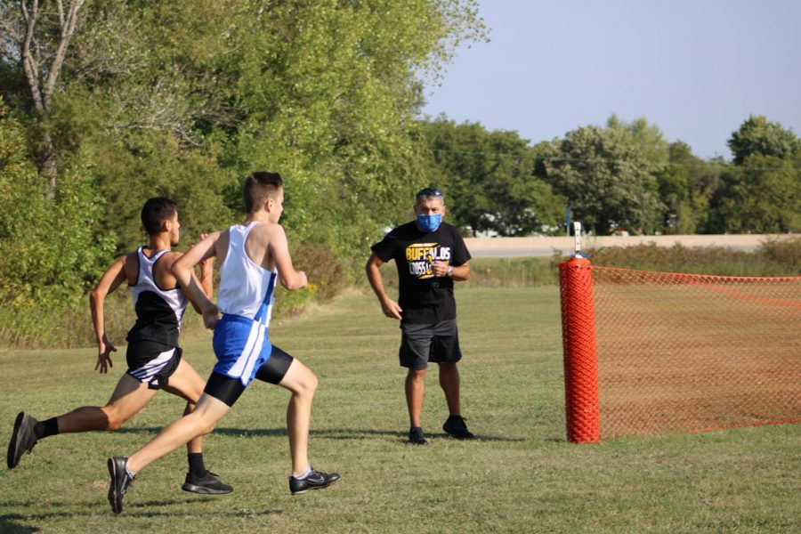 Racing against a Southeast runner to the finish line, freshman Gabe Brown finishes strong.